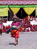 Bhutan - Festivals : After resting up in Bangkok, I joined a Geographic Expeditions tour to Bhutan. We took in two festivals, one in Thimpu and one in the countryside at Thangbimani Lhakhang, both of which were stunning spectacles, plus a thangka raising, also in the countryside near Bumthang at Namkhai Ningpo. For a description of the trip, see www.wilhelmswords.com/asia2001.