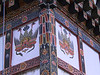Bhutan - Houses : Bhutanese houses traditionally have three stories: the lower for animals, the middle for people, and the upper an open attic for storage, and to keep the shingles dry. It's now illegal to keep animals in the house, so newer houses may have fewer stories. Most houses are elaborately decorated. Images from Himalayan Buddhism are popular, as are protective symbols. Some of these photos are explicit, as the Bhutanese choice of a protective symbol is, like much about Bhutan, a little different.